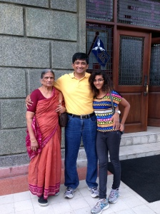 Mother in law, husband and daughter posing for the camera.